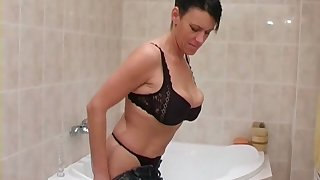 Short haired brunette with huge saggers pisses and takes a shower